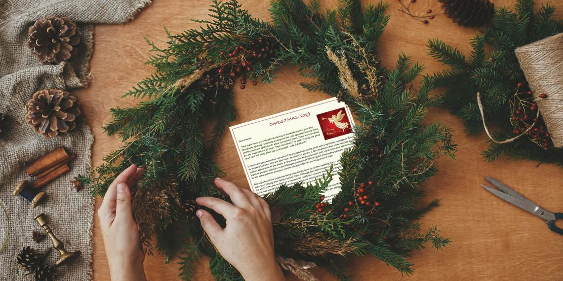 Christmas letter behind a wreath