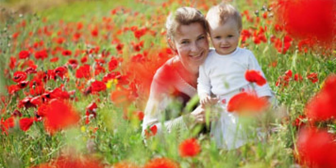 Woman and child in field of flowers